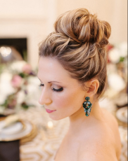 Buns will be elegant forever. This updo is perfectly structured. Not too high, not too tight, not too loose. Via Modwedding.com